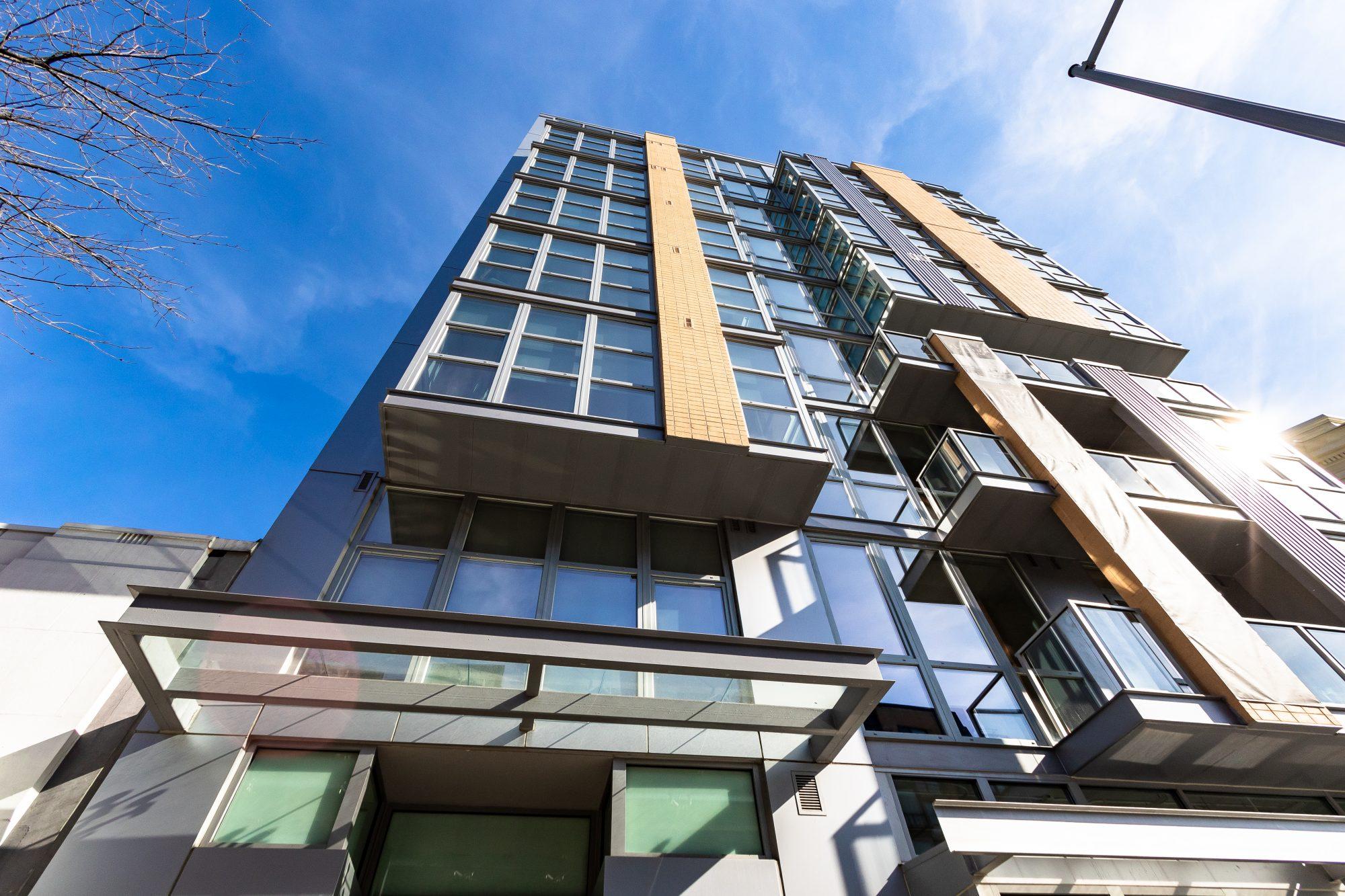 Elysium Fourteen with INTUS Arcade steel reinforced triple pane polymer windows & balcony doors