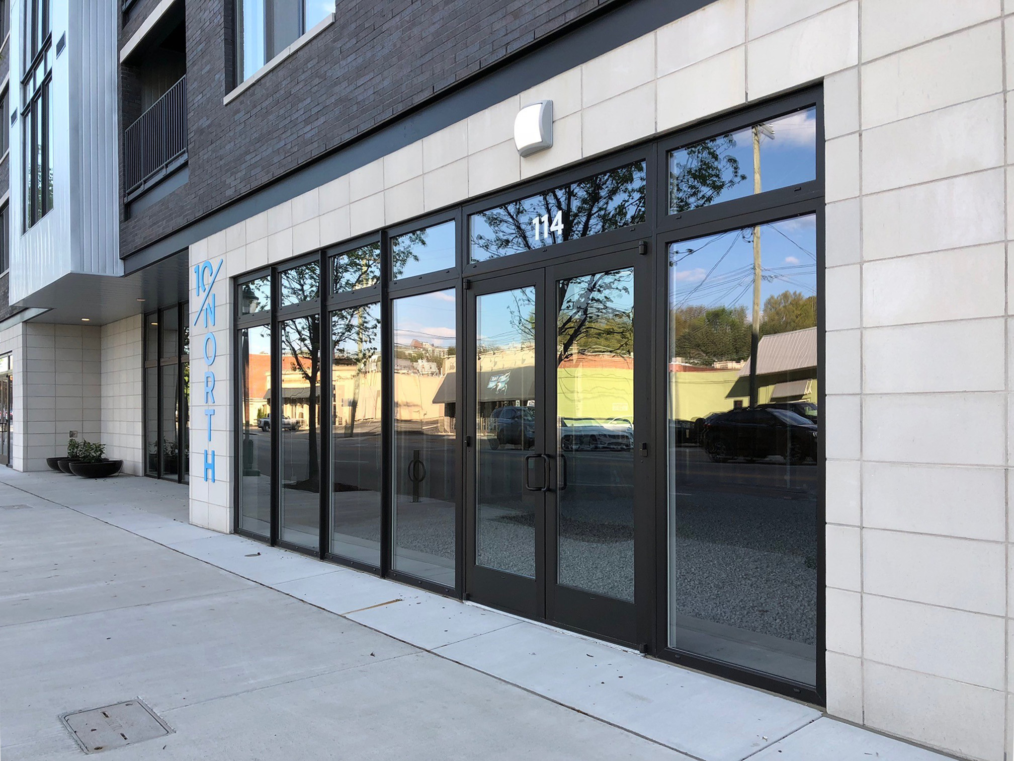 10/North Apartments with INTUS Windows Arcade steel reinforced double pane windows, storefronts, & balcony doors