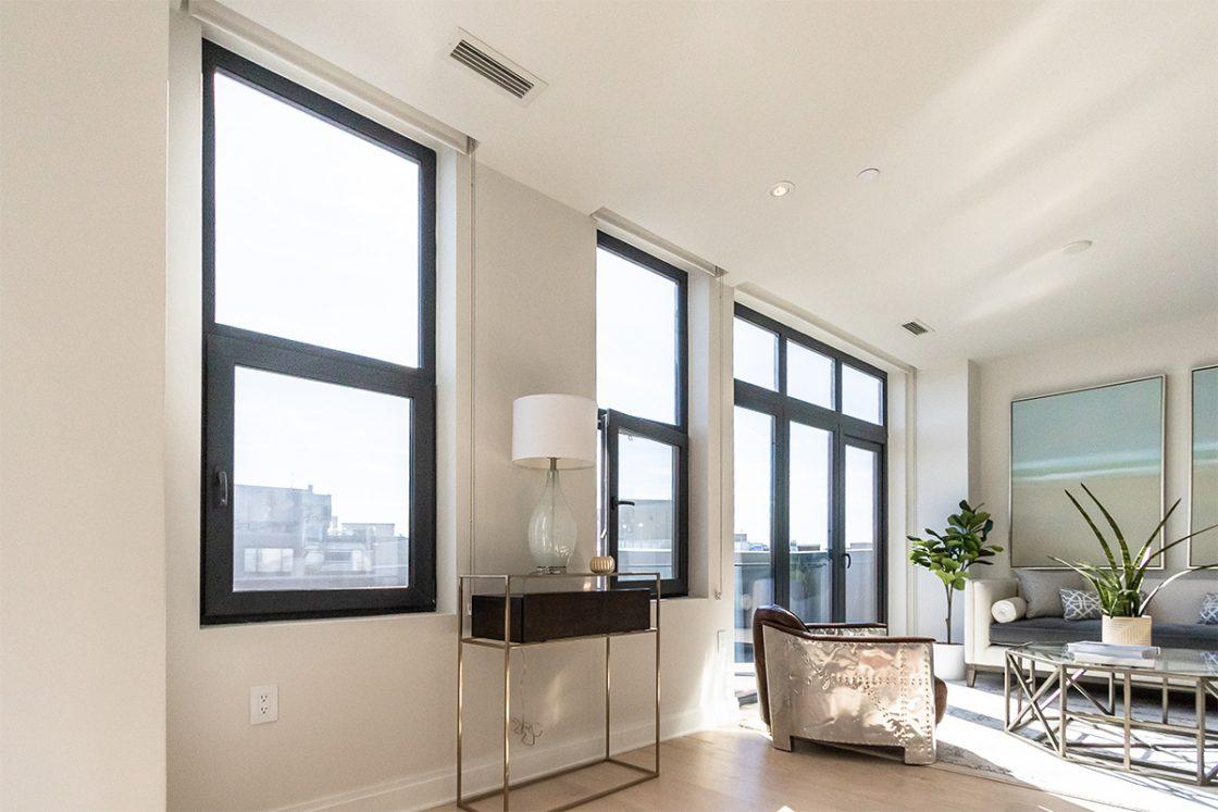 Elysium Logan with INTUS Arcade steel reinforced triple pane polymer windows & window walls