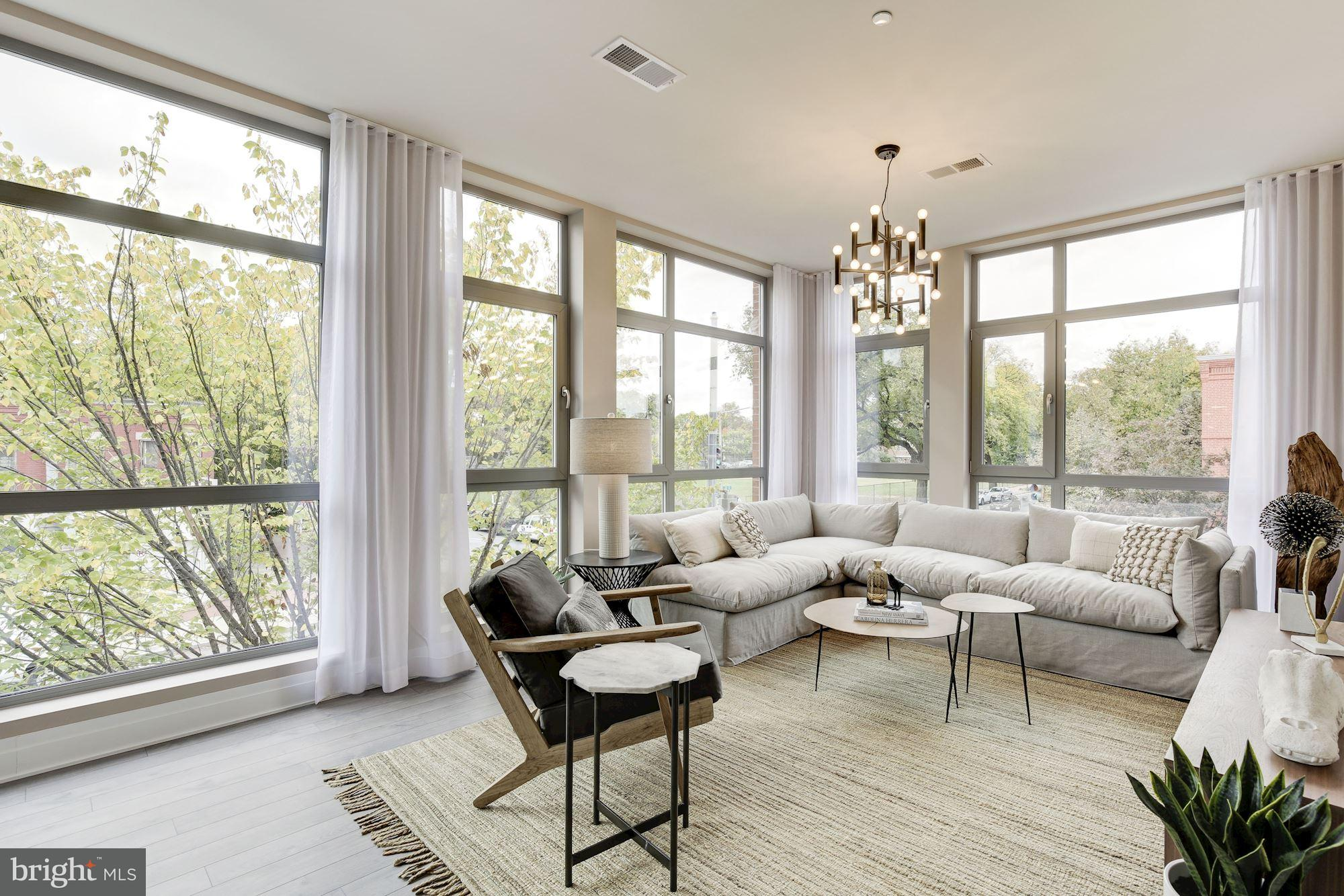 Kipling House with INTUS Windows and Balcony Doors, and interior design by Akseizer Design Group